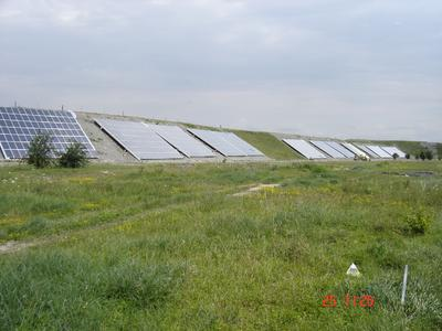 Solar cells are lined up on the exterior perimeter of the embankment to collect solar energy