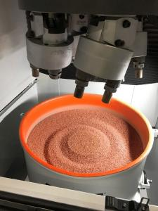 The processing bowl of the plug-and-play drag finisher can be easily exchanged with a fork lift truck. This allows quickly switching from one application to another without having to replace the processing media.   Image courtesy: Rösler Oberflächentechnik