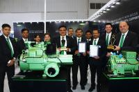 The BITZER team with the two award-winning compressors (Photo: BITZER)
