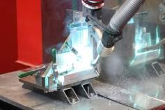 """Fig. 6b: ... with automated welding we can keep up our output even at peak periods"""""""