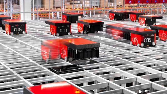 Dematic hat im Siemens-Werk für Kombinationstechnik in Chemnitz (Siemens WKC) eine AutoStore®-Anlage mit mehr als 45.000 Behältern installiert. Die Zusammenstellung der Aufträge übernehmen 34 Roboter. (Foto: Dematic/Gerd Knehr)
