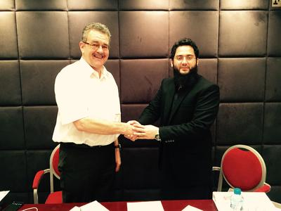 Zeeshan Nasir, CEO of GVT Pvt Ltd (right) and Nicholas Freakes, Senior International Business Consultant at primion Technology AG, seal the System Partner Contract with a handshake