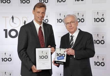 MID Managing Director Jochen Seemann (Left) Receives The Top 100 Award from Lothar Späth (Right).
