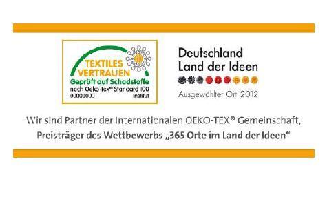 """Mit der Auszeichnung als """"Ausgewählter Ort im Land der Ideen"""" für die Stiftung OEKO-TEX® wird auch die Arbeit der weltweit rund 10.000 zertifizierten Unternehmen gewürdigt. Um dies zu demonstrieren, stellt diesen OEKO-TEX® eine Urkunde und ein Online-Banner mit Bezug auf die Aktion kostenlos zur Verfügung"""