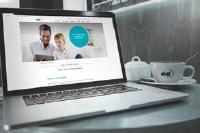 MacBook mit eNet SMART HOME Homepage