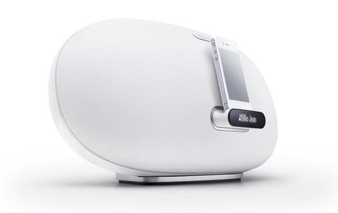 Denon Cocoon Home Weiß Schrägansicht mit angedocktem iPhone