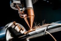 Direct Metal Deposition via Powder Nozzle