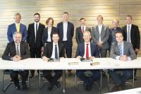 The TenneT and arvato Systems team during the signing of the contract