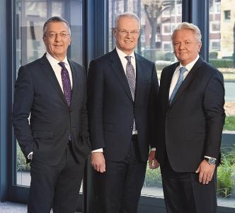 The executive board of Rheinmetall AG: Helmut P. Merch (finance), Peter Sebastian Krause (human resources) and Armin Papperger (chairman) / Photo: Rheinmetall AG