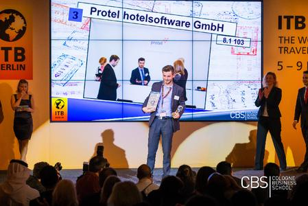 "Felix Heidenreich, Sales Area Manager at protel hotelsoftware, accepts the ""Best Exhibitor Award"" (BEA) at the CBS Award Show at the ITB 2014."