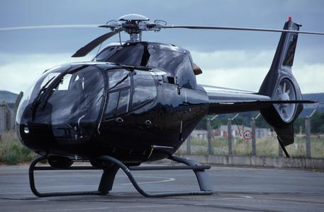 EC120B on ground is enclosed (© Copyright Eurocopter, Patrick Penna).