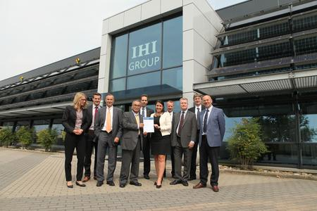 The Bosch-Ionbond team in front of the new building in the Netherlands. Dr. Kawasaki, Chairman of the Board of Directors of IHI Ionbond and Joe Haggerty CEO of Ionbond (third from the right) receive the Preferred Supplier award from Tilmann Röhrborn (third from the left) and Tina Mayer