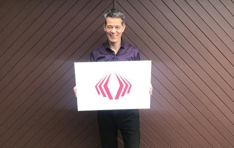 Simon Dunkley, TALQ Consortium, holding the TALQ symbol