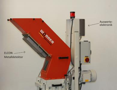 Metal detector ELCON from Sesotec installed below the material chute of the Xtra granulator from Wanner