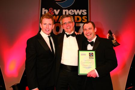 Laing's UK Sales Manager Robin Pomreinke (middle) accepts the  Industrial / Commercial Heating Product of the Year Award from David Lettis of sponsor Mitsubishi Heavy Industries (right) and TV personality Patrick Kielty (left).
