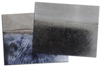Elektropoliertes Edelstahlblech vor (unten) und nach (oben) dem Bad in der Nachtauchlösung SurTec 542