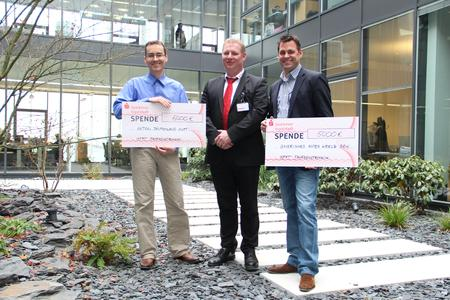 Cheque presentation with Dieter Hauenstein (centre), BRK's deputy head of local emergency operations, and BFFT directors Michael Mittag (left) and Markus Fichtner (right).