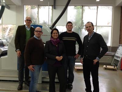 Genius 52UV at Stiels Werbedruck GmbH & Co. KG in Nettetal. Ralf Engels of Heinrich Steuber, Stefan Stiels, Managing Director of Stiels-Werbedruck, Sandra Ulsamer, Regional Sales Director KBA-MePrint, Sven Tappesser, printer at Stiels-Werbedruck, and Jakob Stiels, Managing Director at Stiels-Werbedruck (left to right)