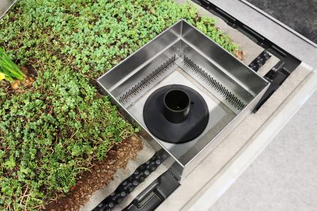"""The """"Stormwater Management Roof"""" specifically stores large quantities of water on the roof, allowing it to run off into the sewer system in a time delay, to prevent the threat of flooding."""