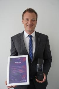 "HARTING Automotive Managing Director Marco Grinblats beams after Harting Automotive received the Volkswagen Group Award 2020 in the ""E-Mobility"" category"