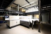 Bei dem erstmalig großtechnisch umgesetzten Teppichdruckverfahren werden die Farben eines Musters wie bei einem Tintenstrahldrucker auf den Teppich aufgetragen. Foto: VETEX