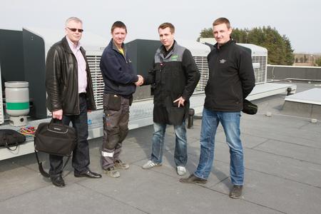 Handshake (left to right): Uldis Osenieks, Edgars Zalitis, Jan Grübel and Martins Podnieks at the handover of the ECOSTAR system.