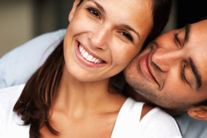 Embracing love Pretty woman smiling while man cuddles her - togethermedien.net