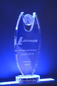 "With its ADAMS® technology for filling powder-type products into watertight PE bags, HAVER & BOECKER was able to win LAFARGE Global Supplier Award 2014 in the category of ""sustainability"""