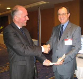 John Verity of ITSO presents the certificate to John Clarkson, Almex UK General Manager