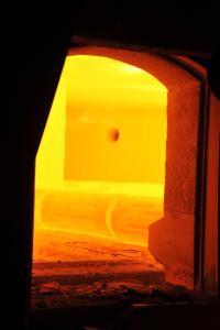 Hot ingot ready for forging