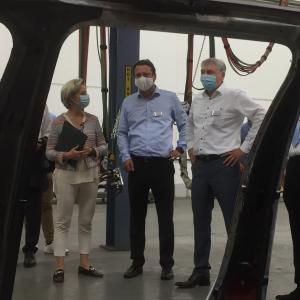 During the visit of the Baden-Württemberg Minister of Economic Affairs Dr. Nicole Hoffmeister-Kraut (left), Dr. Robert Hentschel, Senior Vice President Engineering Valmet Automotive Group, gives an outlook on the plans of the company at the Helmstadt-Bargen site; on the right Klaus Wetzstein (Director Prototyping/ Small series Valmet Automotive Engineering)