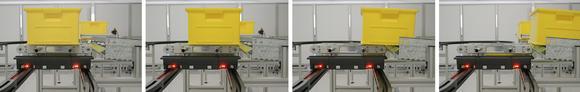 Ein automatischer Abladeprozess von Materialkisten mit dem auf dem intelligenten Transportroboter Servus angedockten Lean Loader