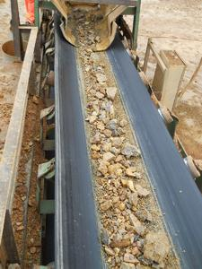 Clean material on conveyor