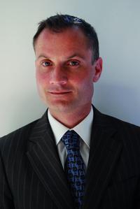 Mr. Takis Antoniadis, Manager Spain