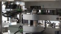 Efficient production of plastic-metal hybrids on turntable injection moulding machines