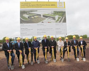 Mario Lange, Chairman of the HARTING Logistics Works Council, Andreas Conrad, Senior Vice President Operations; Dr. Michael Pütz, Director of Human Resources, Plant and Legal Affair; Dietmar Harting, Member of the Board; Philip Harting, Chairman of the HARTING Technology Group Board; Espelkamp's mayor Heinrich Vieker; Maresa Harting-Hertz, Member of the Board Finance and Purchasing; Margrit Harting, Partner; Jens Grünert, Managing Partner LIST Bau Bielefeld GmbH, and Achim Meyer, General Manager HARTING Logistics, lend a hand at the official groundbreaking ceremony (from left to right).