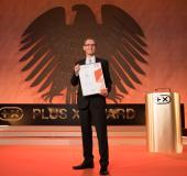 Dr. Andreas Runkel, Pressesprecher der Göde Unternehmensgruppe, nahm die Plus X Award-Urkunde für den PakSafe entgegen.