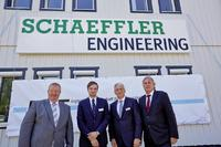 Christian Degenhardt, founder and former managing director of IFT Ingenieurgesellschaft für Triebwerkstechnik mbH, Christopher Lehne, Rolf Laufs (both Schaeffler Engineering), and Prof. Dr.-Ing. Peter Gutzmer, Deputy CEO and Chief Technology Officer at Schaeffler AG (left to right) unveiled the new company sign symbolizing the merger of Schaeffler Engineering and IFT at the company's main building in Clausthal-Zellerfeld. Image: Schaeffler Engineering