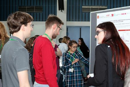 Scientists engaging in fruitful discussions during the poster session of PicoQuant's Quantum Symposium.