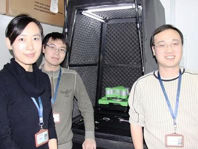 Professor Yi Cao, right, and two of his students with the JPK ForceRobot® system in the Institute of Biophysics at Nanjing University.