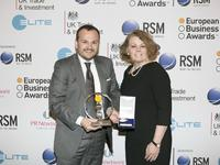 Daniel Fabbiano, BMZ Works Manager, receives the trophy for  'The RSM Entrepreneur of the Year Award' ‒ on behalf of BMZ founder and  owner Sven Bauer ‒ from Jean Stephens, CEO of RSM