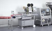 Poly-clip System (c) ICA - high volume cooked ham, large diameters in record time, automatic clipper
