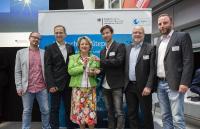 DAIKIN, e-design und Hörburger belegten den 3. Platz beim Deutschen Kältepreis 2018. Abbildung: © co2online/Raum11/Zappner