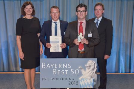 """C 0: Bernd Krebs and Christoph Hauck being presented with the coveted award """"Bayerns Best 50""""."""