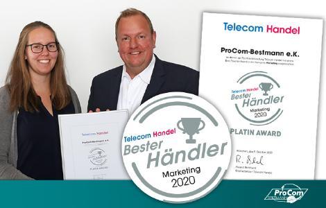 """Jens und Alina Bestmann mit der Platin-Award-Auszeichnung """"Bester Händler Marketing 2020"""" der Telecom Handel"""