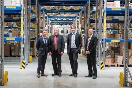 Schafften die Umstellung in sechs Monaten: Die Herren Michael Ahnemann und Björn Meder von KBU-Logistik, Christopher Wallraff, Sven Wollthan (Hausmann Wynen) (v.l.n.r.)