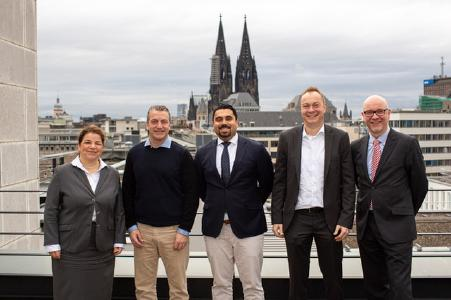 The picture shows Anna Bejaoui, General Manager of EVO Payments Germany, Craig Vodnik, CEO & Founder of cleverbridge, Arash Hatami, Business Development Manager of EVO Payments Germany, Robin Blume, Managing Director of cleverbridge Financial Services GmbH and Heiko Dwillies, Head of Implementation, EVO Payments Germany