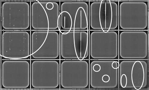 Photolumineszenz-Aufnahme einer Siliziumkarbid-Halbleiterscheibe mit teilprozessierten Bauelementen. Markiert sind auffällige Strukturen, die zu funktionsunfähigen oder im Betrieb unzuverlässigen Bauelementen führen. Copyright: Fraunhofer IISB