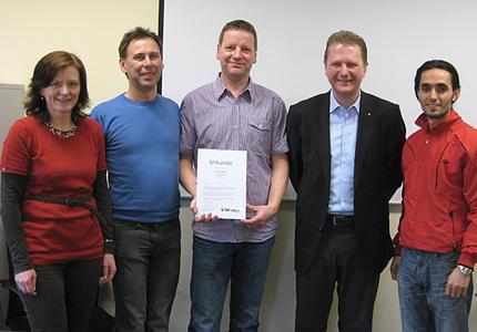 Ivo Hirseland und Achim Hager (dritter und vierter v. links) im Kreise von Kollegen